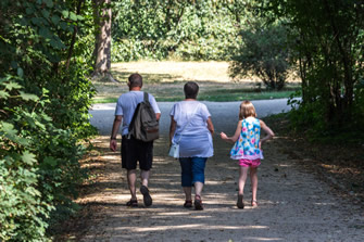 a family is strolling through a parc
